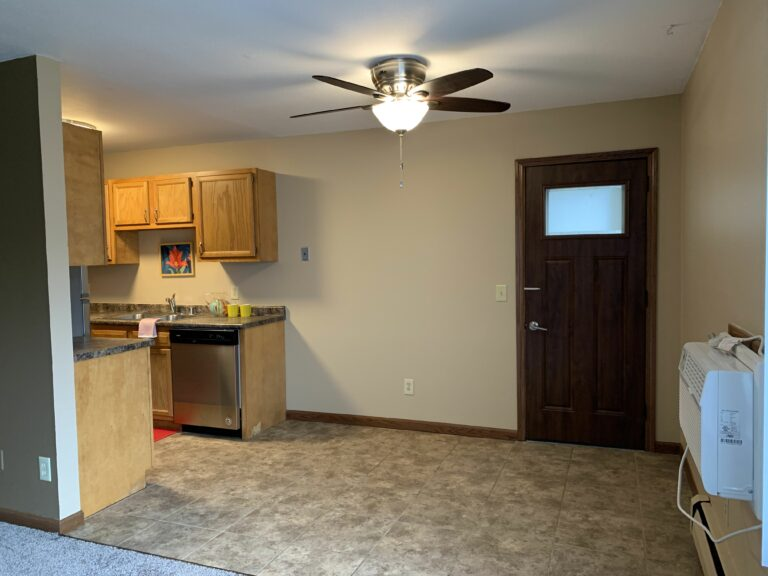Kitchen, dining area, and patio door